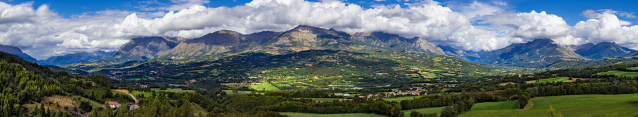 Panoramic summer afternoon view on the Champsaur and the Drac Valley. From left to right the villages of Saint-Bonnet-en-Champsaur abd Saint-Julien-en-Champsaur. Hautes-Alpes, PACA, France Wall mural