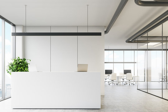 White office with a reception desk