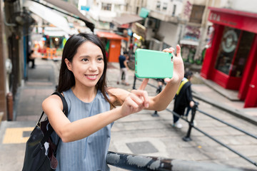 Young woman travel in Pottinger Street and taking photo