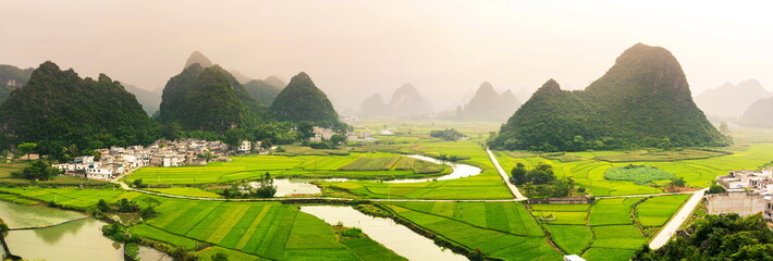 Photo sur Toile Chine Stunning rice field view with karst formations China