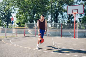 Basketball player dribbling a ball