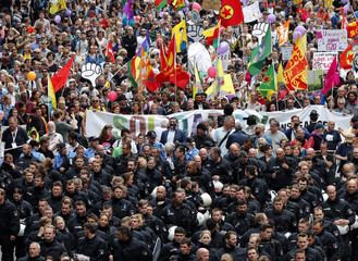 German police walk in front of protesters during a demonstration at the G20 summit in Hamburg