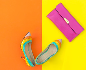 Fashion woman accessories set. Trendy fashion shoes heels, stylish handbag clutch. Colorfull background.  Lifestyle Concept.
