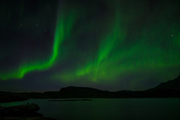 Northern lights at night over a lake