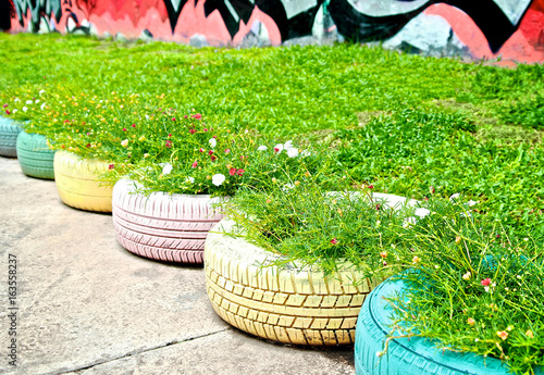 Recycle of tyre used in public park. Flowers and plant in old tire on tire art, tire landscaping, tire jewelry, tire fences, tire ponds, tire walls, tire water features, tire concrete, tire trees, spring designs, roof garden designs, tube garden designs, tire furniture,