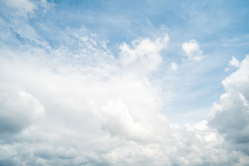 Blue sky with fluffy cloud, natural background.