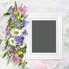 Vintage background with frame and a bouquet of summer meadow flower