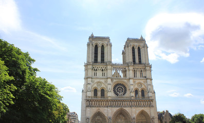 Notre Dame de Paris, medieval catholic cathedral in Paris, France.  Beautiful view of french gothic architecture, one of the most famous church building in the world.