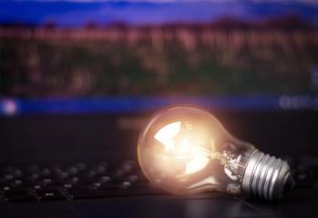 Light bulb on keyboard laptop.