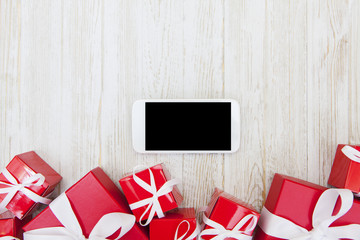 Christmas Gifts with Blank Smart Phone and copy space