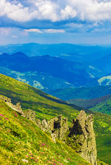 Panoramic view of the sky and mountain ridges from the top of the mountain in a sunny summer day