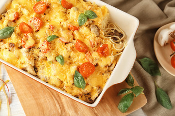 Delicious roasted turkey tetrazzini in baking dish on kitchen table