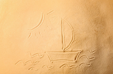 Boat drawn on sea sand, closeup view