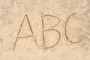 abc letters written in sand