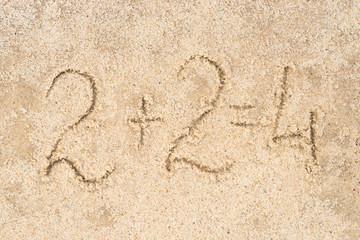 2+2=4 written in sand
