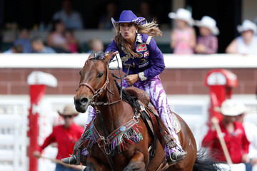 Wall of Roosevelt, Utah races her horse in the barrel racing event during the rodeo at the Calgary Stampede in Calgary