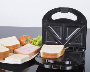 Sandwich maker opened on white background