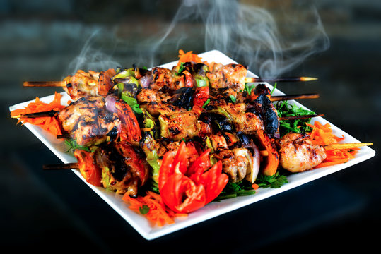 Meals of chicks, meat, shish tawook, rice and appetizers , grilled