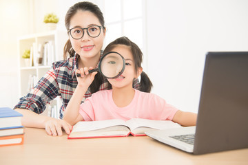 portrait of glasses woman teacher and young girl