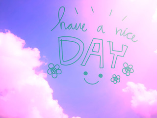 Have a nice day word and smile face on pink pastel sky