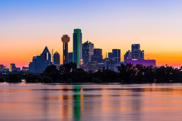 Dallas skyline at sunrise with water reflections Wall mural