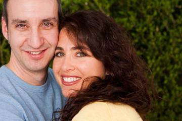 Portrait of a happy couple outside.