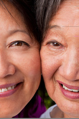 Mature Asian mother and her adult daughter.