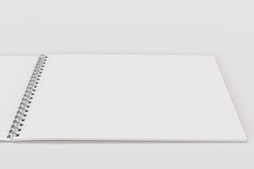 Open blank white notebook with metal spiral bound on white background