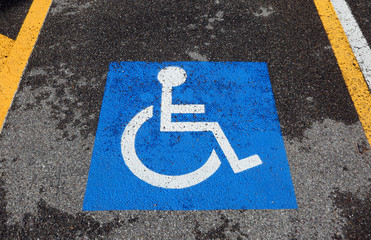 reserved parking car with wheelchair symbol