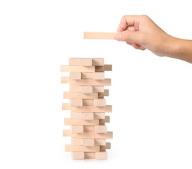 hand playing wood blocks stack game