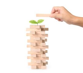 hand playing wood blocks stack game