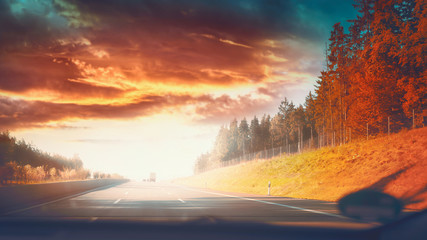 Highway road in autumnal landscape with Beautiful sky and sunlight, fall travel concept