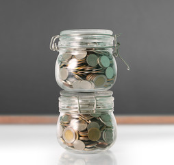 Silver coins in piggy bank Glass