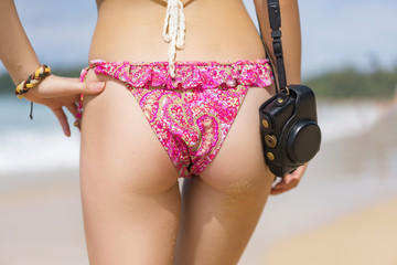 Sporty beautiful lady buttocks with a camera