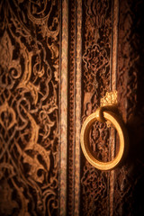 Wooden door Arabic decorations and ring lever