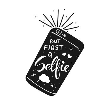 but first selfie hand written quote on a smartphone in black and white