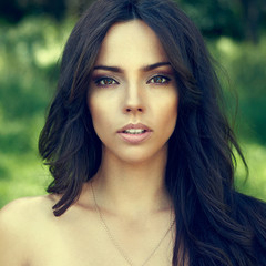 Beautiful woman face outdoor portrait - close up