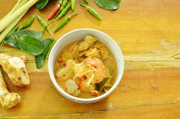 spicy prawn and fish tom yum soup in bowl