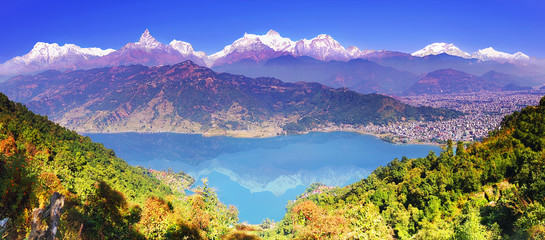Pokhara valley, Phewa lake and the magnificent Annapurna mountain range from hillside. Himalayas, horizontal panoramic view