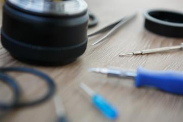 Broken DSLR lens repair service in workshop