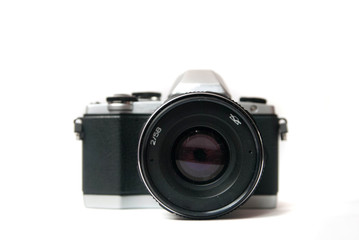 Retro camera with metal lens on white background