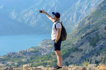 Selfi tourist on the background of the mountains