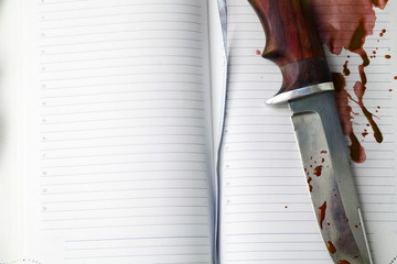 Knife and notebook