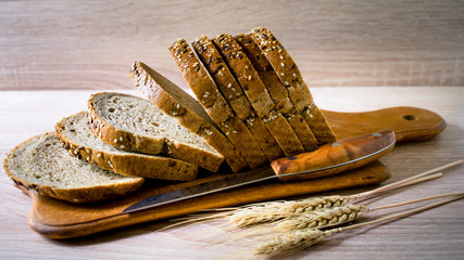 Sliced grain bread on a wooden Board