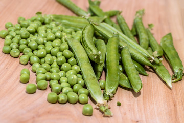 Fresh peas on a wooden board