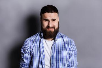 Feeling upset, sad bearded man portrait