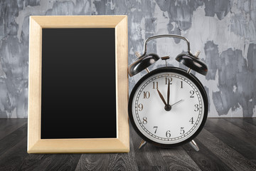 frame and clock on a wooden table
