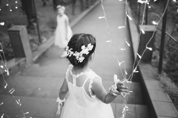 Young beautiful girl holds garlands. Black and white