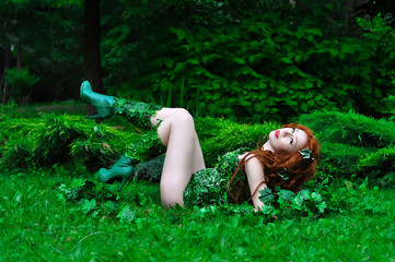 Young beautiful red-haired girl in the image of the comic book poison ivy