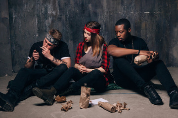 Bad habits. People smokes and drink alcohol. Poor youth company get drunk. Woman with little baby. Men smokes, drinks. Maternal harm, careless lifestyle, social problem, negative addiction concept